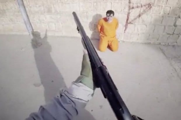 ISIS Spray Paint Target On Mans Head In Sick Execution Video 54101UNILAD imageoptim Prisoner with graffiti on his head 678402