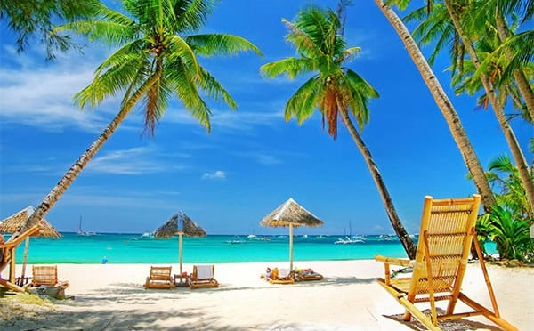 This Awesome Boss Pays His Employees To Go On Vacation wsi imageoptim tropical beach chairs 600x372