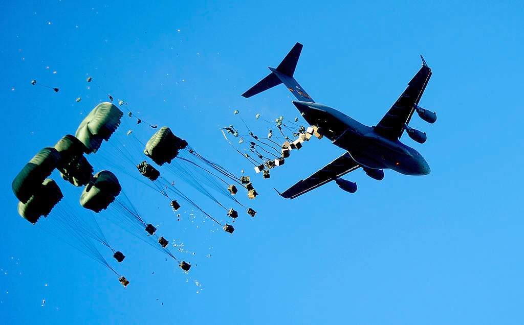 This Is Where WWIII Will Probably Start 21414UNILAD imageoptim 1024px USAF C 17 airdrops supplies for Haiti