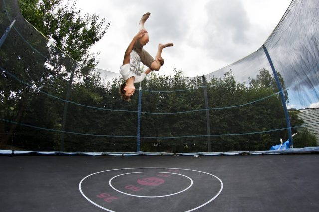 These Are The Everyday Things Doctors Refuse To Have In Their Houses 54754UNILAD imageoptim Jumper doing flip on trampoline with safety net 2012 640x426