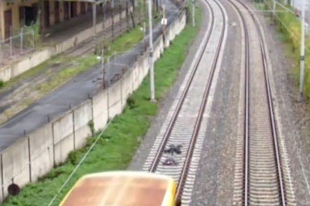 two-boys-lie-down-on-tracks-in-front-of-fast-moving-train-3