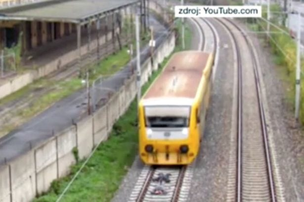 two-boys-lie-down-on-tracks-in-front-of-fast-moving-train-2