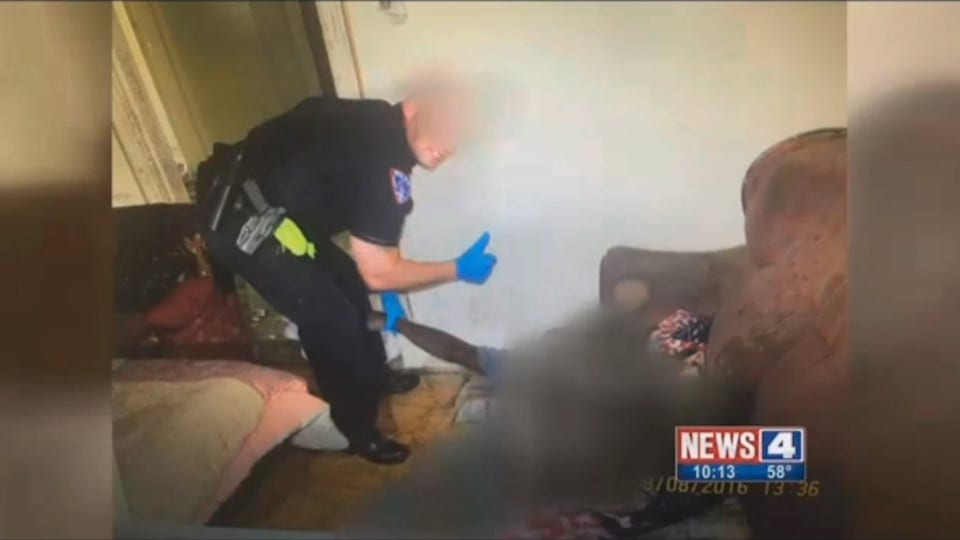 Police Take Sickening Photo With A Dead Body