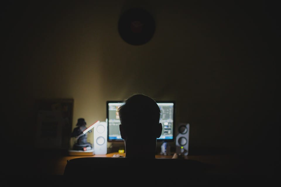 man staring at computer screen
