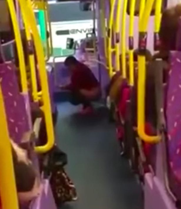 Passengers Film As Woman Does Poo In Front Of Everyone On A Bus 1080 Woman appears to take a POO on middle of a bus 1