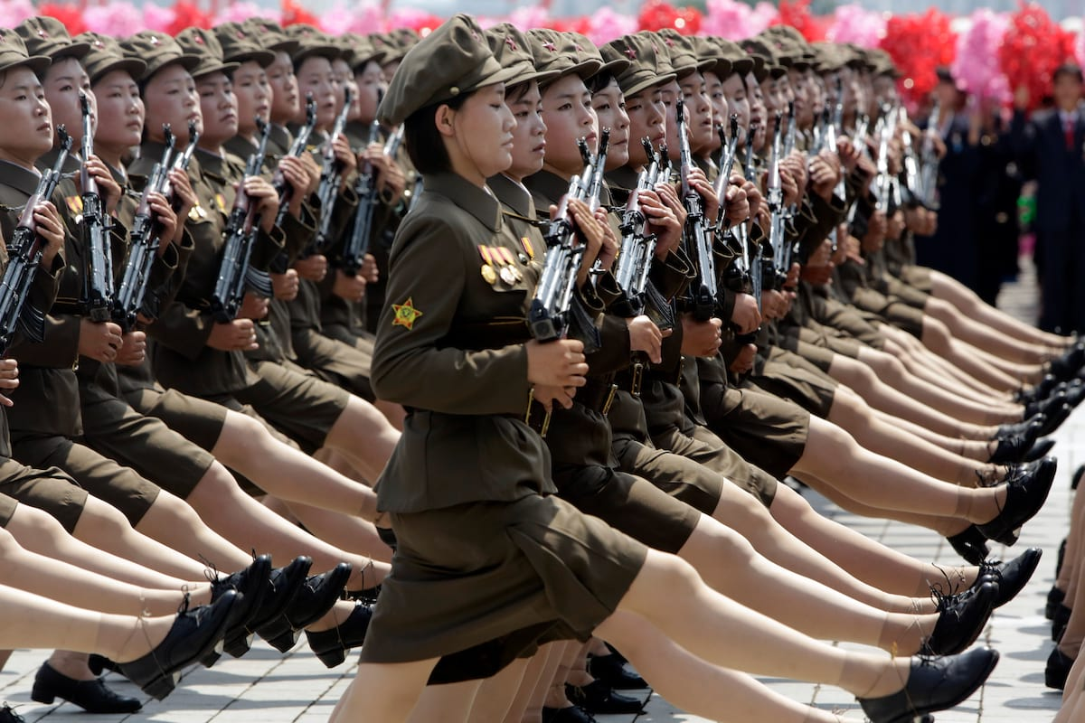 Above a mountain near Pyongyang, the women, who are picked from school and  university, undergo military training just as tough and exhausting as any  other.