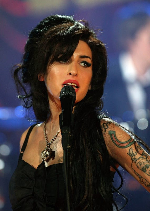 Singer and 27 Club meber, Amy Winehouse, singing on stage