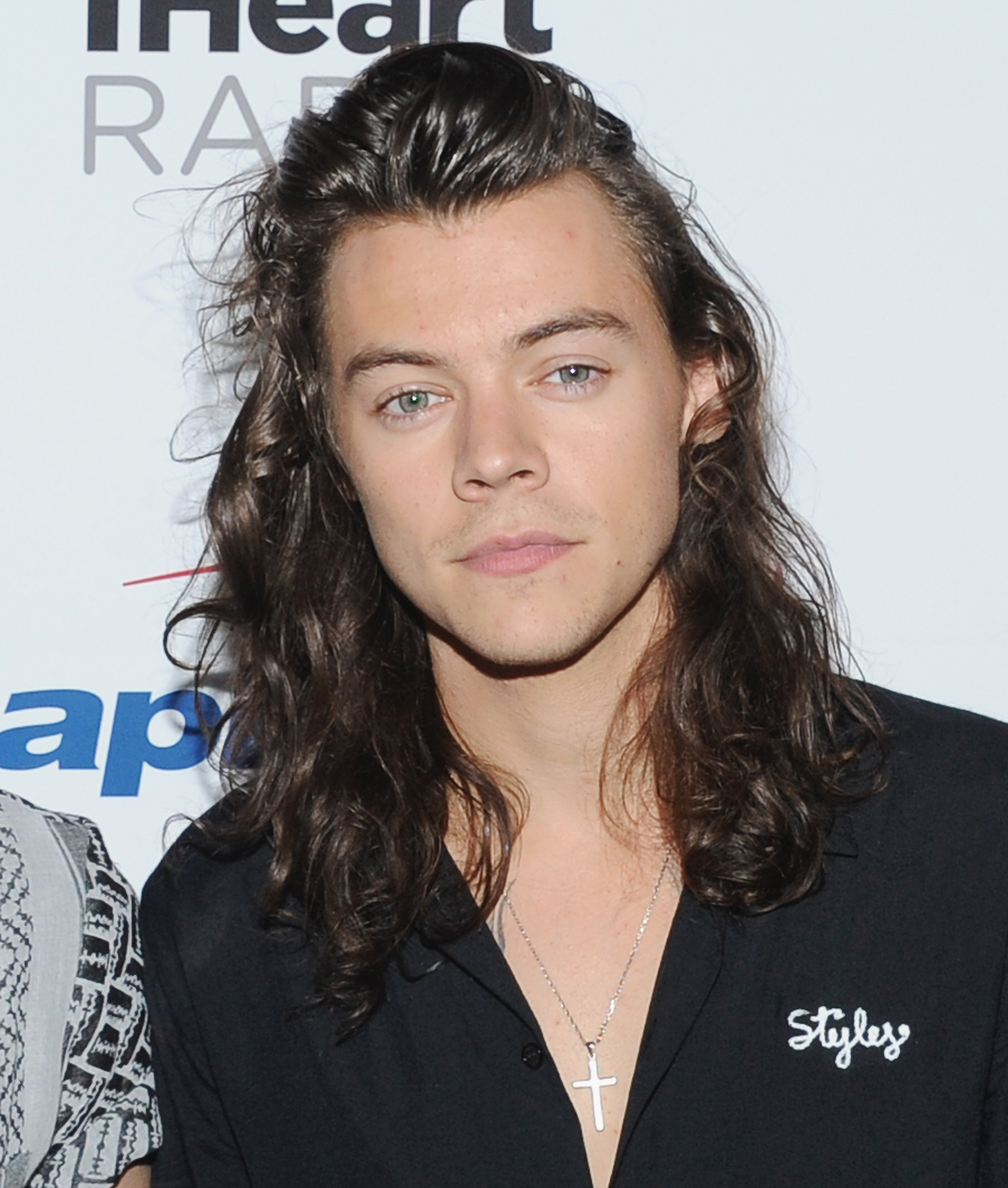 famous hair style there s something suspicious about harry styles new song 7010 | GettyImages 500025534
