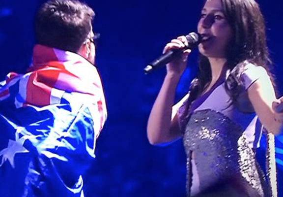Guy In Australia Flag Flashes Bum After Invading Stage During Eurovision Song Contest