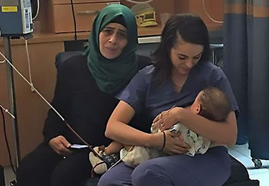 Image Of Nurse Breastfeeding Baby Goes Viral For Most Incredible Reason