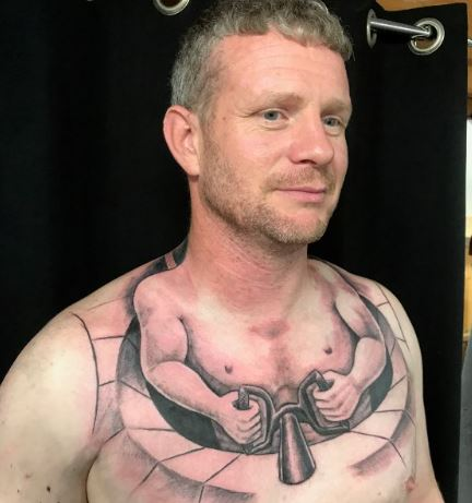 Truckers Tattoo Makes Him Look Like Tiny Man Driving His Own Body Capture erf23