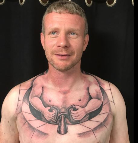 Truckers Tattoo Makes Him Look Like Tiny Man Driving His Own Body Capture erff