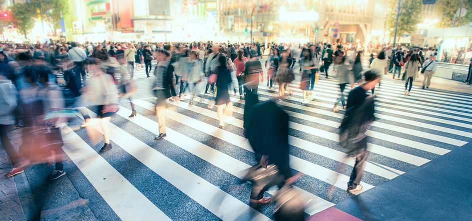 stock image of a busy pedestrian scene at a zebra crossing