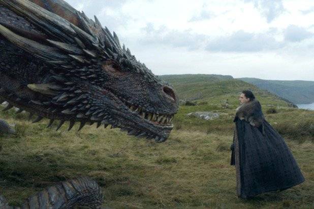 Jon Snow looks at Drogon the dragon in Game of Thrones