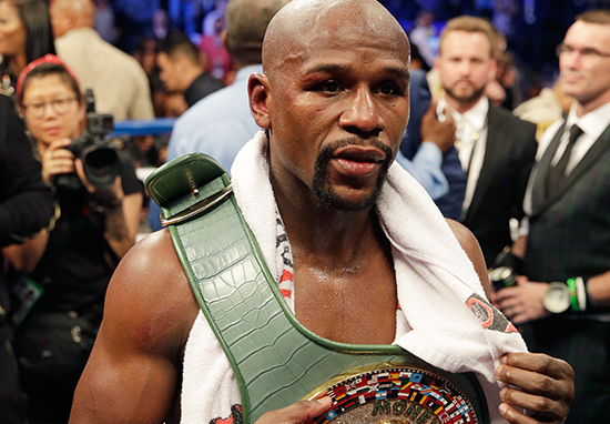 Floyd Mayweather wearing the 'moneybelt' he defeated Conor McGregor to claim.