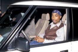 Tupac riding in a car