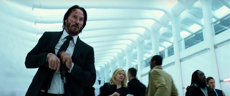 a bloodied Keanu Reeves stars as the assassin John Wick