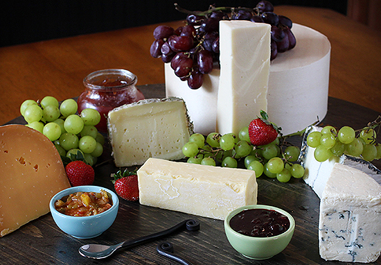 Traditional cheese board with grapes and preserves