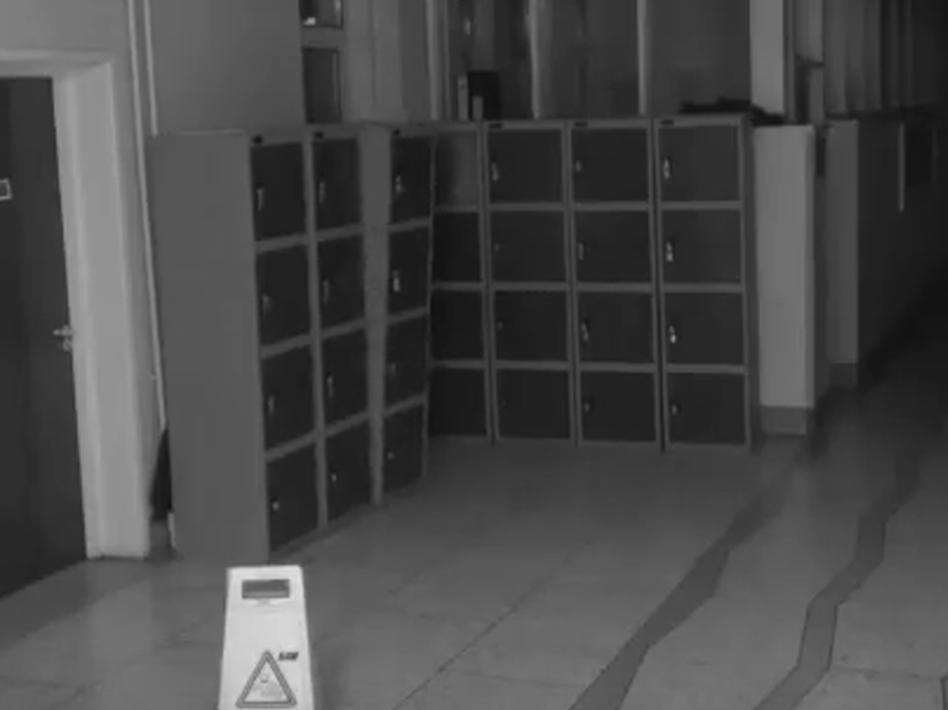 School CCTV Camera Captures Terrifying Ghost In Hallway lockers shaking 1