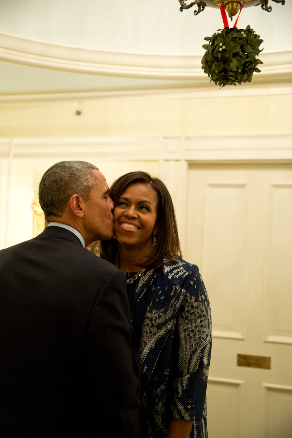 First Lady Michelle Obama Kissed On Cheek By Husband, Barack.