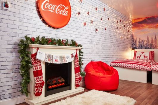 You Can Now Spend A Night In the Coca Cola Christmas Truck fireplace 1