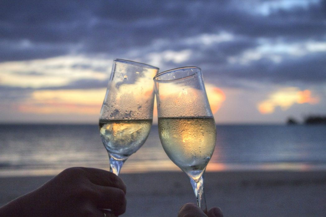 New Years Eve Is The Best Holiday Of The Year sea sunset beach couple 1048x700