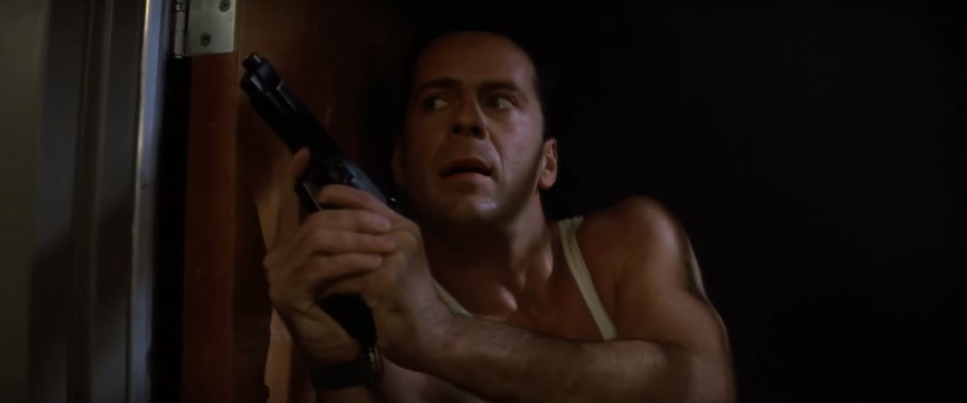 Bruce Willis as . John McClane in Die Hard