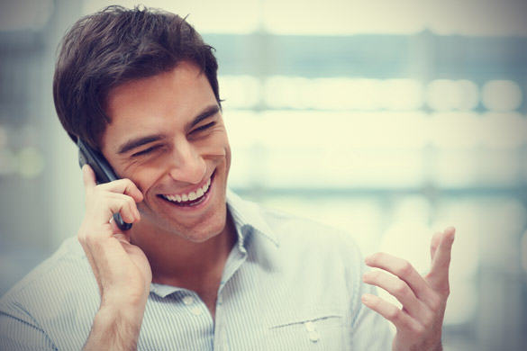 Brits Are Actually Much Happier Than They Think They Are happy man having a phone call