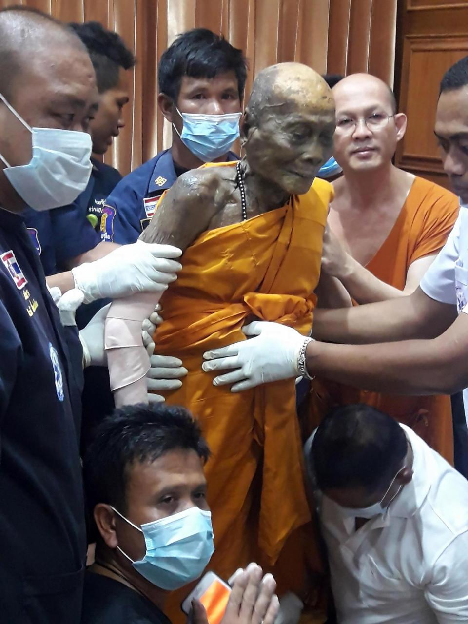 Monk Smiles After Body Unearthed Two Months After Death 6801d7885a66a0ab1cbe6d5f7f2da6f7