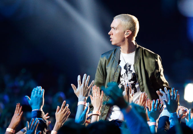 Eminem performs onstage at the 2014 MTV Movie Awards