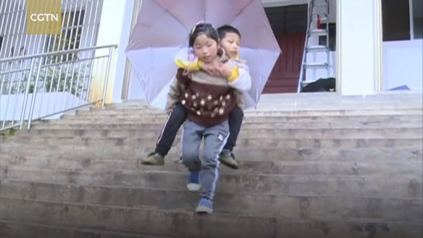 Girl Carries Disabled Little Brother To School Every Day The 9 year old girl who carries disabled brother to school every day 1