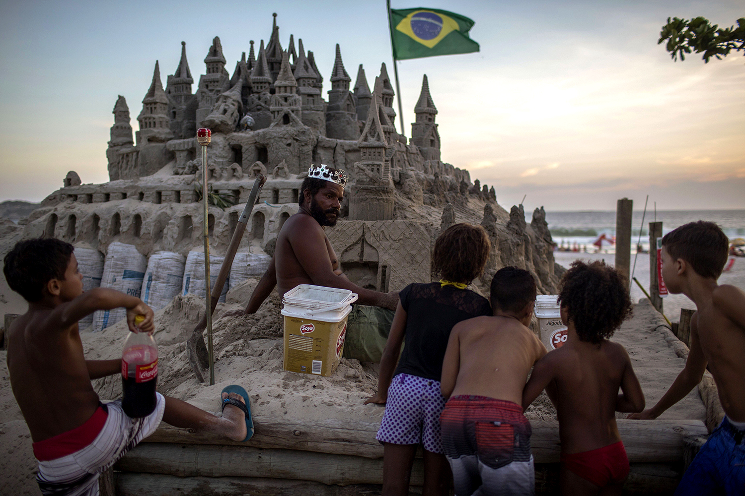 This Man Has Lived In A Sand Castle For Over 20 Years sand castle man throne GettyImages 907298912
