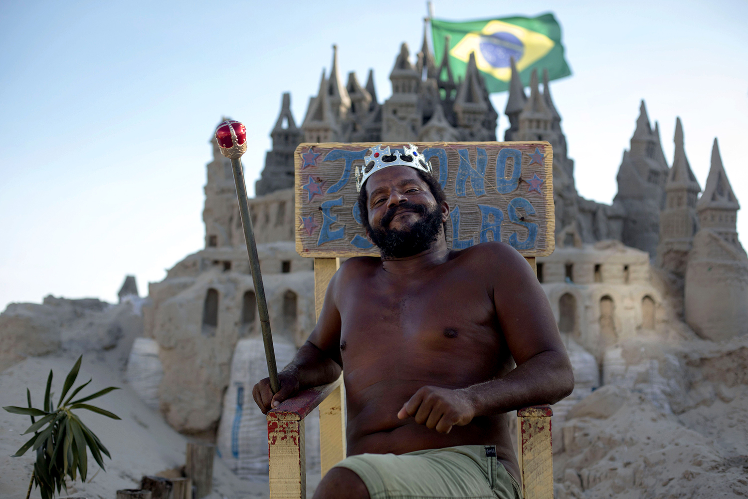 This Man Has Lived In A Sand Castle For Over 20 Years sand castle man throne GettyImages 907299022