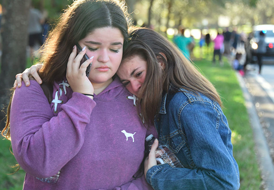 Students react after a school shooting in Florida
