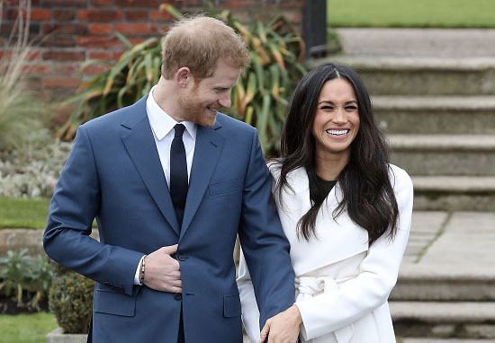 prince harry and meghan markle pose for a photo after announcing their engagement