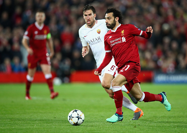 Mohamed Salah of Liverpool moves away from Kevin Strootman of AS Roma during the UEFA Champions League Semi Final First Leg match between Liverpool and A.S. Roma at Anfield on April 24, 2018 in Liverpool, United Kingdom.