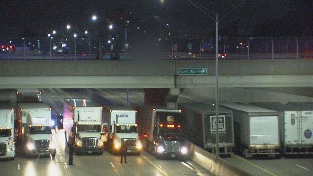 13 Trucks Park Side By Side Under Bridge To Stop Man Killing Himself