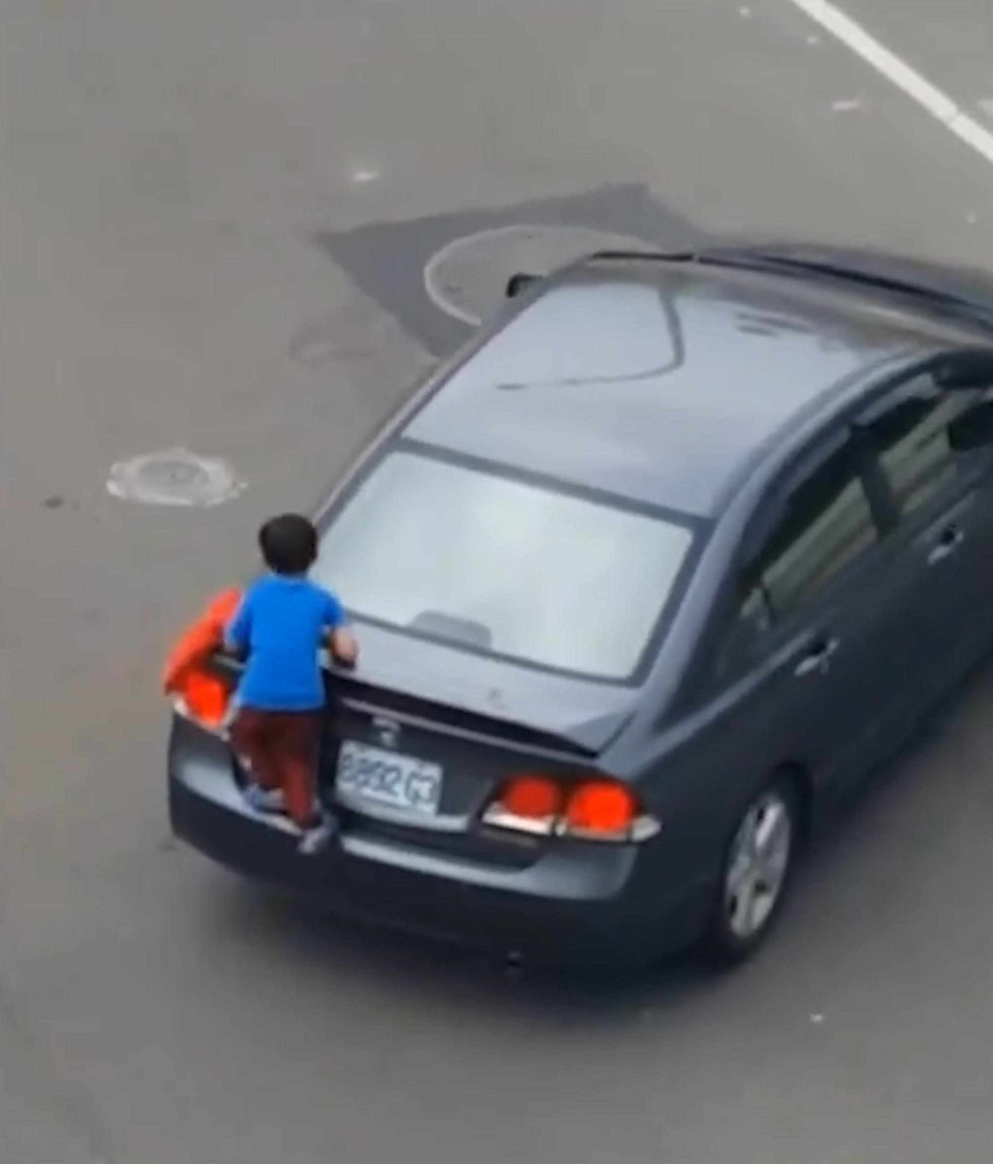 Boy Clings To Mothers Car As She Drives Off As Punishment unnamed 2