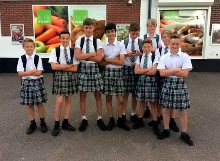 Schoolboys wearing skirts in the heat