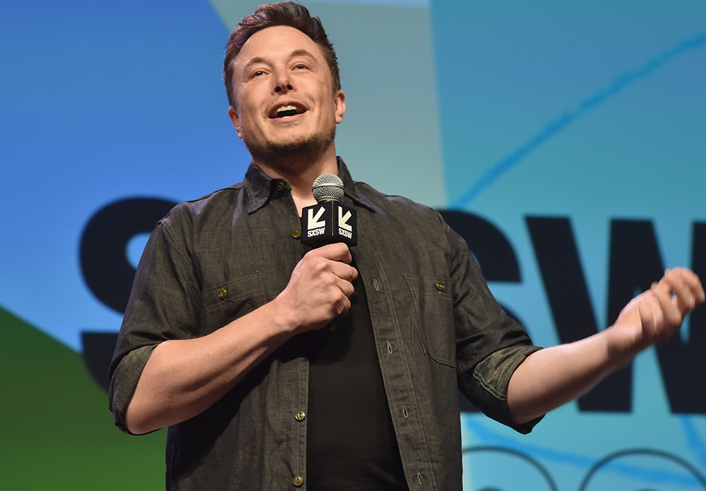 Elon Musk speaking at a conference