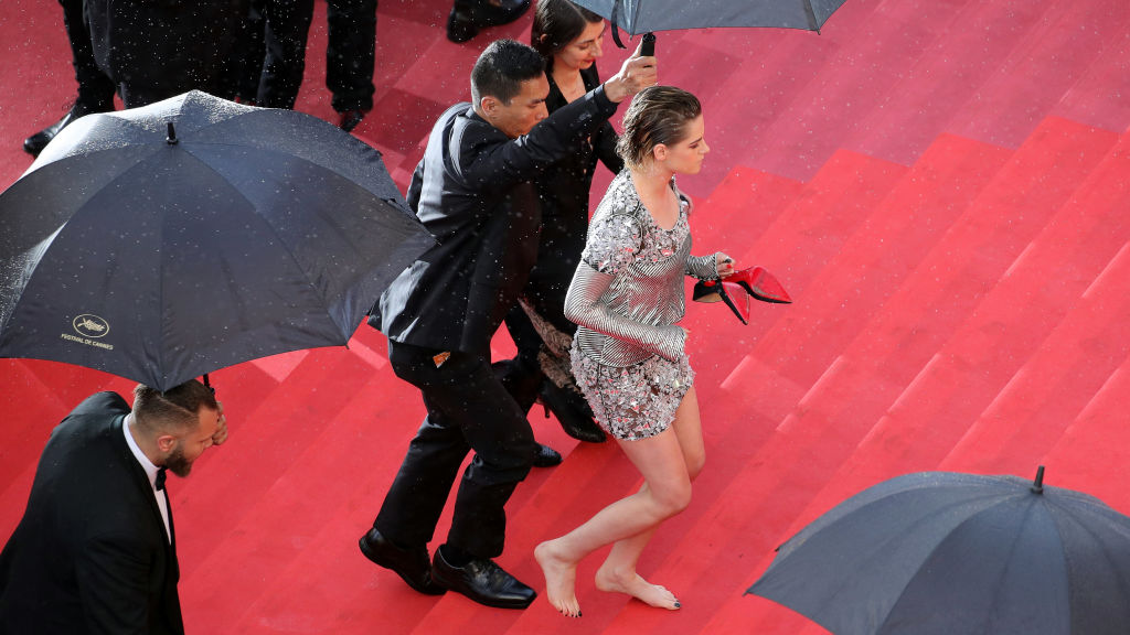 Kirsten Stewart removes her shoes at the Cannes Film Festival