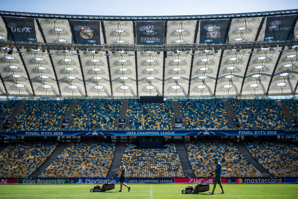 Football pitch being mowed in Kiev before Champions League