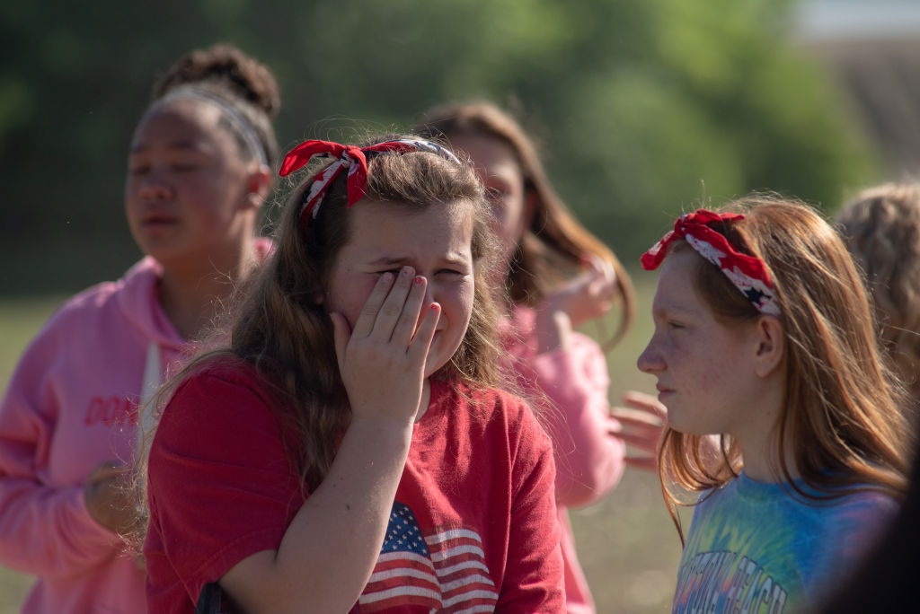 Students react outside Noblesville West Middle School after a shooting at the school on May 25, 2018