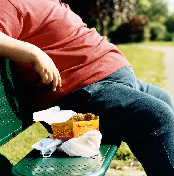 Overweight Man Sitting With Take-Away Food