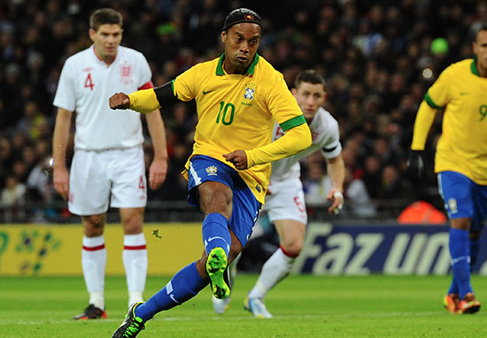 Ronaldinho of Brazil shoots and sees his penalty saved