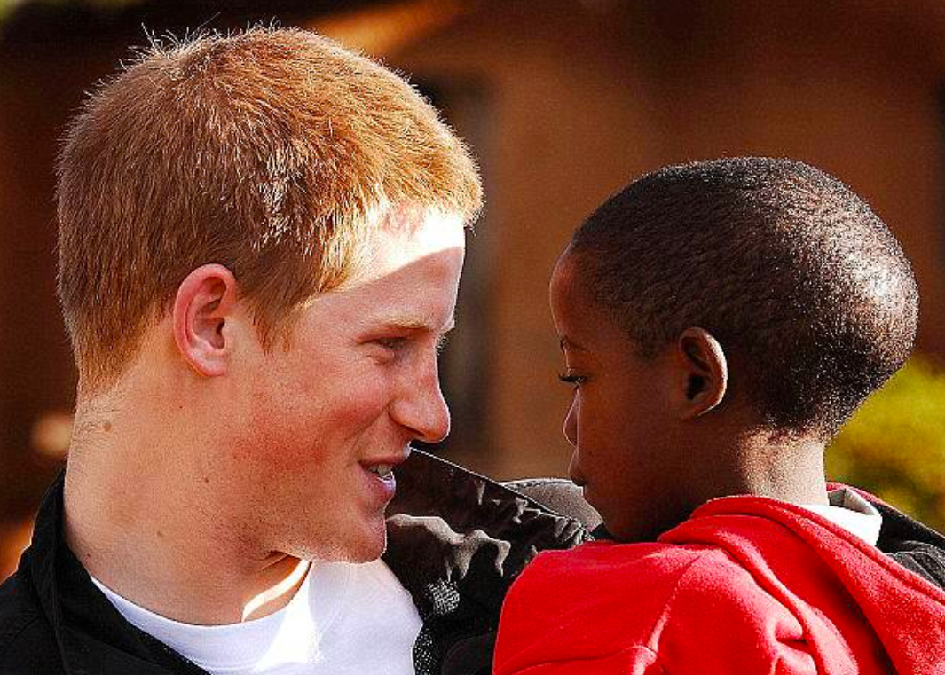 Prince Harry with Orphan Potsane