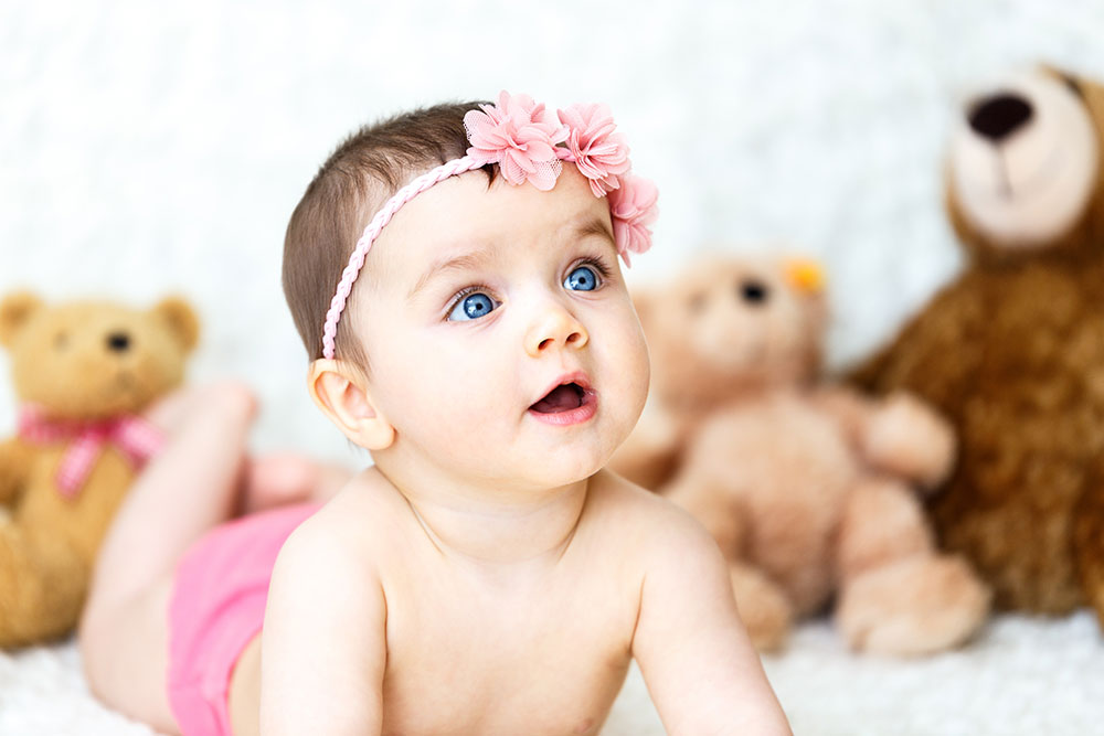 stock image of baby girl playing with toys