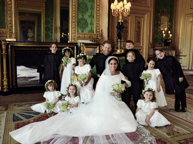 official photo of the Royal Wedding Meghan and Harry pose with their flower girls and page boys