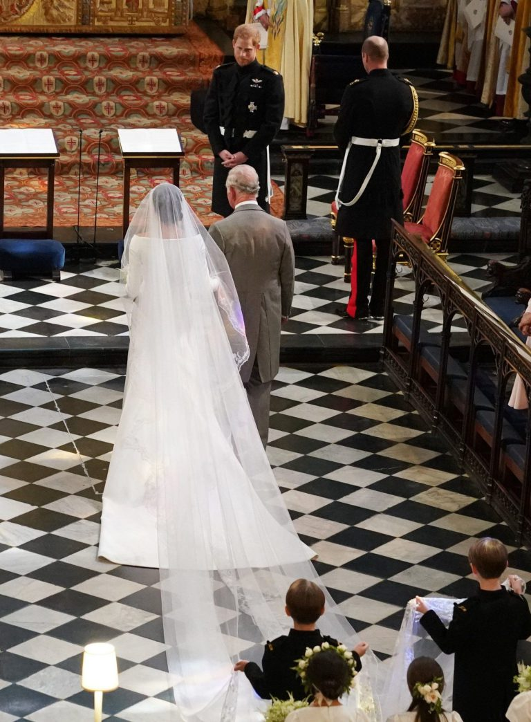 Meghan Markle, accompanied by Prince Charles, walks to the alter at her wedding to Prince