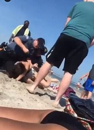 police punch woman head sunbathing